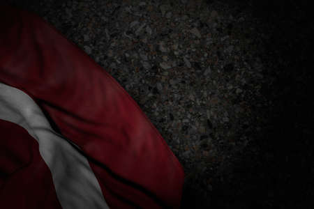 cute dark picture of Latvia flag with large folds on dark asphalt with free place for text - any holiday flag 3d illustration