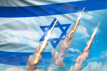 Israel nuclear missile launch - modern strategic nuclear rocket weapons concept on blue sky background, military industrial 3D illustration with flag 版權商用圖片