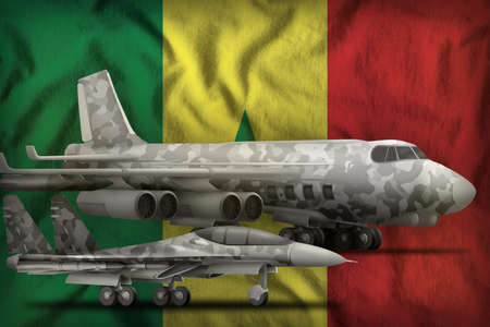 air forces with gray camouflage on the Senegal flag background. Senegal air forces concept. 3d Illustration