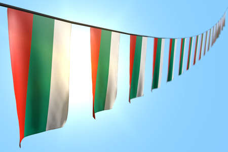 nice many Bulgaria flags or banners hangs diagonal on rope on blue sky background with bokeh - any holiday flag 3d illustration