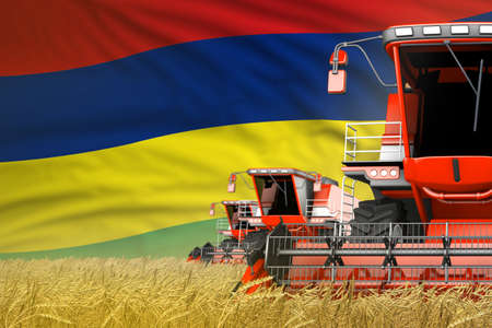 industrial 3D illustration of three red modern combine harvesters with Mauritius flag on wheat field - close view, farming concept Imagens