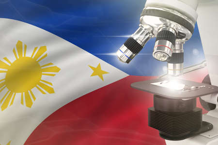 Philippines science development concept - microscope on flag background. Research in pharmaceutical industry or cell life 3D illustration of object