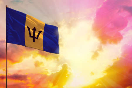 Fluttering Barbados flag in left top corner mockup with the place for your information on beautiful colorful sunset or sunrise background. Imagens - 159438111