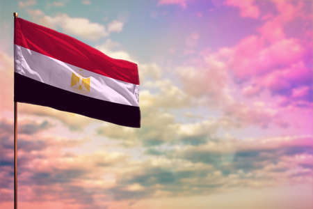 Fluttering Egypt flag mockup with the place for your text on colorful cloudy sky background. Stock fotó