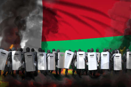 Madagascar police guards in heavy smoke and fire protecting state against mutiny - protest fighting concept, military 3D Illustration on flag background