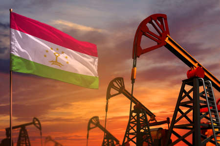 Tajikistan oil industry concept, industrial illustration. Tajikistan flag and oil wells and the red and blue sunset or sunrise sky background - 3D illustration