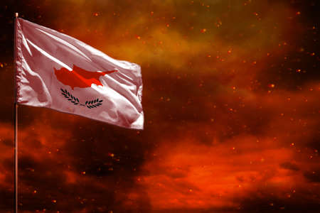 Fluttering Cyprus flag mockup with blank space for your data on crimson red sky with smoke pillars background. Cyprus problems concept.