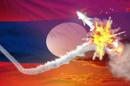 Lao People Democratic Republic intercepted supersonic warhead, modern antirocket destroys enemy missile concept, military industrial 3D illustration with flag 写真素材