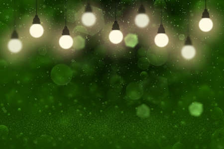 green pretty shiny abstract background glitter lights with light bulbs and falling snow flakes fly defocused bokeh - festal mockup texture with blank space for your content