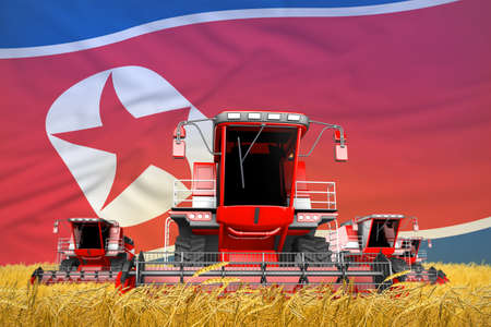 four bright red combine harvesters on grain field with flag background, North Korea agriculture concept - industrial 3D illustration