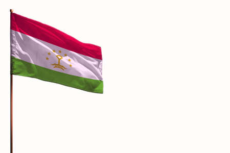 Fluttering Tajikistan flag isolated, mockup with the place for your text on white background.