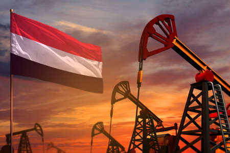 Yemen oil industry concept, industrial illustration. Yemen flag and oil wells and the red and blue sunset or sunrise sky background - 3D illustration Banque d'images