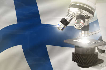 Finland science development concept - microscope on flag background. Research in pharmaceutical industry or biochemistry 3D illustration of object
