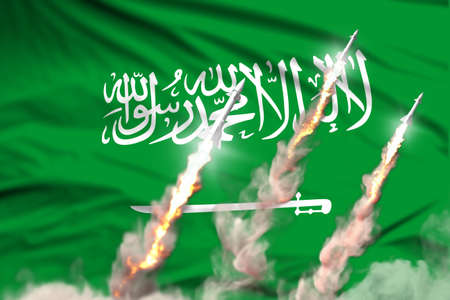 Modern strategic rocket forces concept on flag fabric background, Saudi Arabia nuclear missile attack - military industrial 3D illustration, nuke with flag Banco de Imagens