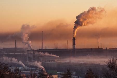 smoke from tube of ironworks Фото со стока