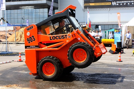 May 31 2011g.rossiya.moskva. IEC Crocus Expo ``. 12th International Specialized Exhibition of `Civil Engineering and Technology 2011 . In the photo: mini loader Locust.