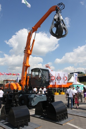 May 31 2011g.rossiya.moskva.IEC Crocus Expo ``. 12th International Specialized Exhibition of `Civil Engineering and Technology 2011 . In the picture: a special bucket capture an excavator.