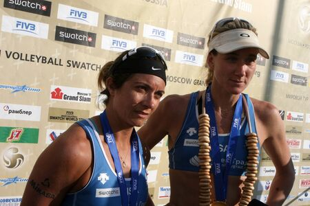 Rossiya.Moskva.16 July 2011g.Etap World Tour Beach Volleyball Women - tournament Grand Slam.This photo shows the winners of the tournament Olympic champions Kerri Walsh of the United States and Misty May-Treanor
