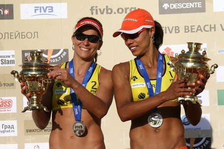 Rossiya.Moskva.16 July 2011g.Etap World Tour Beach Volleyball Women - tournament Grand Slam.This photo shows the athlete from Brazil, Juliana da Silva and Felibersta Larissa Frenchman (right) - silver medalists.