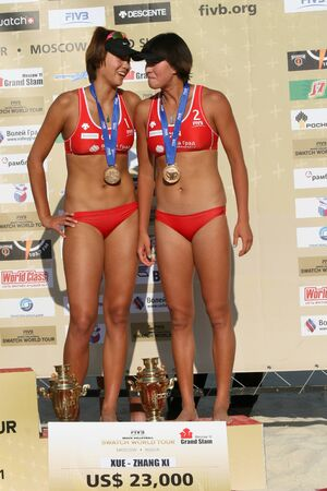 Rossiya.Moskva.16 July 2011g.Etap World Tour Beach Volleyball Women - tournament Grand Slam.This photo shows a Chinese athlete Chen Xue and Zhang Xi - bronze medalists Editorial