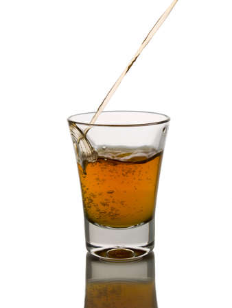 rhum: Pouring a shot of whisky.