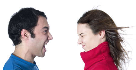 A man screaming at her girlfriend on white background. photo