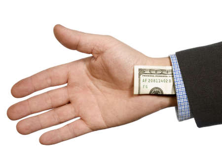 cheater: A mans hand hiding a one hundred dollar bill up his sleeve.
