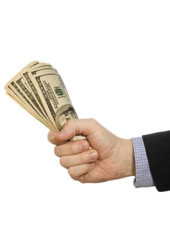 punhado: A mans hand holding a handful of dollars. Banco de Imagens