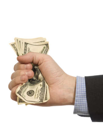 A mans hand holding a handful of dollars. photo