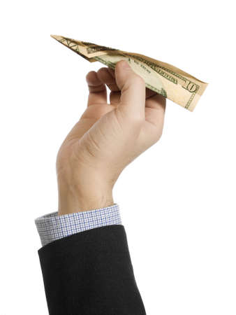 10 fingers: A mans hand about to throw a paper plane made of a ten dollar bill. Stock Photo
