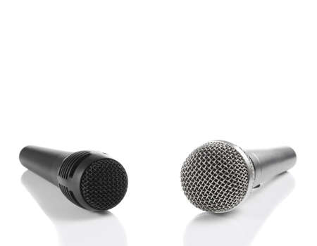 A black and a silver microphones isolated with copyspace. Stock Photo - 3773027