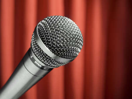 shure: A dynamic microphone over a red background. Stock Photo