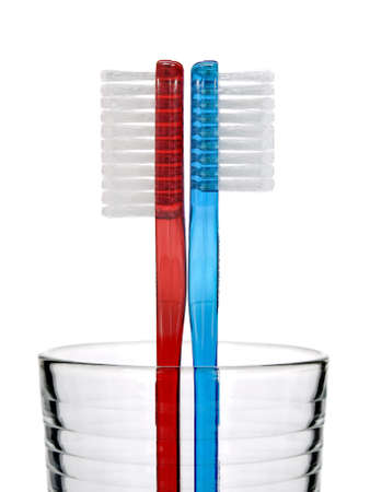 Two toothbrushes in a glass over white background. Stock Photo - 4082012