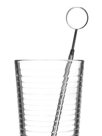 A mouth mirror in a glass isolated on white. Stock Photo - 4269358