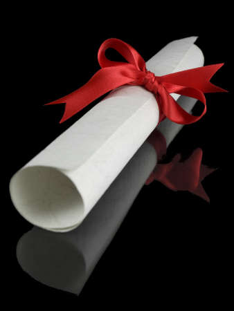 baccalaureate: Diploma with a red silk ribbon, isolated on black background. Stock Photo