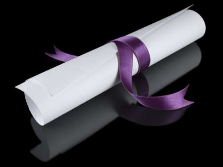 baccalaureate: Diploma with a violet silk ribbon, isolated on black background.