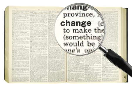 A magnifying glass on the word CHANGE on a dictionary.