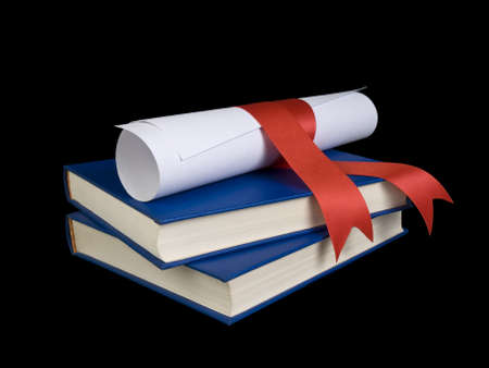 mba: A diploma with red ribbon over blue books.