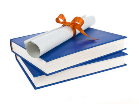 baccalaureate: A diploma with orange ribbon over blue books. Isolated on white.