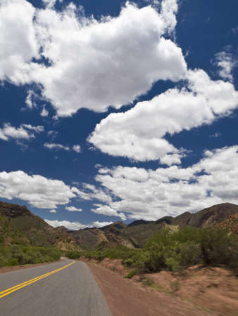 Driving on a road through a mountain landscape. Stock Photo - 4378159