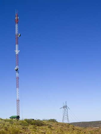 Cellular communication antenna on a blue sky background. photo