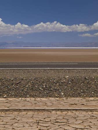 strata: A set of different geological strata in a desert near a salt field.