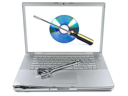 Damaged laptop with a spanner over it and a technical support icon on the screen. Isolated on white.