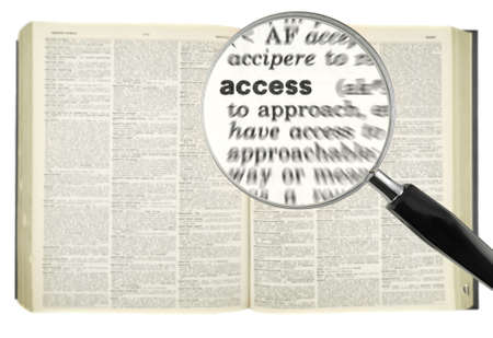 A magnifying glass on the word ACCESS on a dictionary. photo