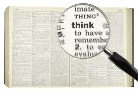 A magnifying glass on the word THINK on a dictionary. photo