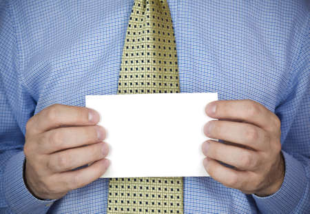An office man holding a blank card with his hands. Stock Photo - 4802428
