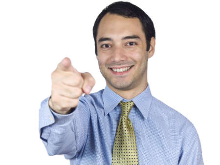 A young businessman smiling and pointing at you. photo