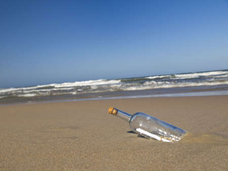 A message in a bottle abandoned on a beach. Stock Photo - 4952372