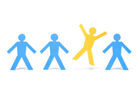 A yellow paper figure is celebrating between other blue paper figures.