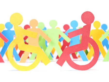 handicap people: Two paper men on wheelchair. Multicolor paper crew on the background.